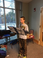 Zack entertains the residents with his clarinet.