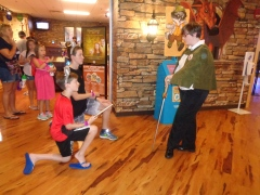 Getting knighted after their quest at Great Wolf Lodge.